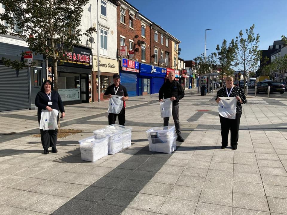 The BID hands out COVID-19 goody bags in Carters Green